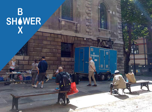The ShowerBox team set up in their usual spot at St Giles Church, central London. © ShowerBox